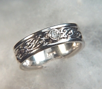 14kt white gold initial wedding band with .10ct diamond