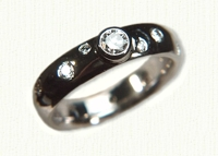 14KW polka dot wedding bands with center .25ct diamond